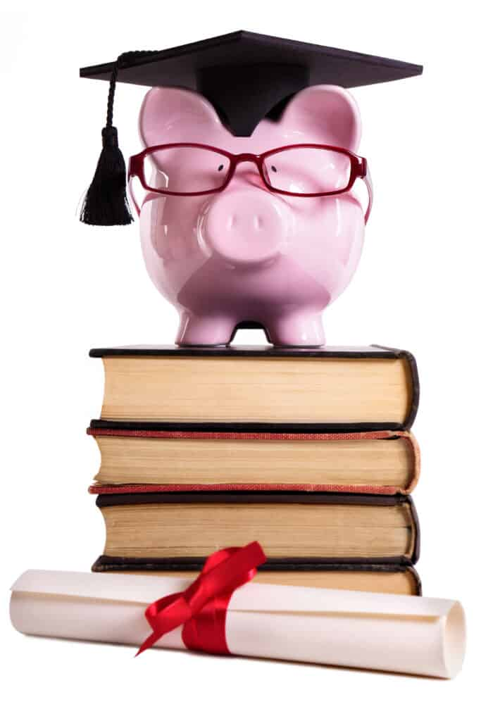 save for college piggy bank on books