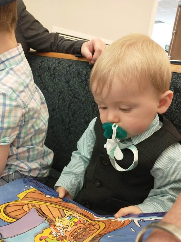 toddler sitting quiet at church