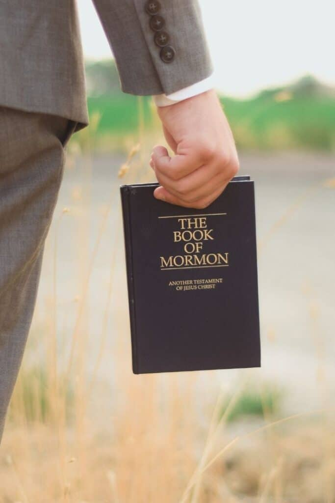 Christian man holding the Book of Mormon