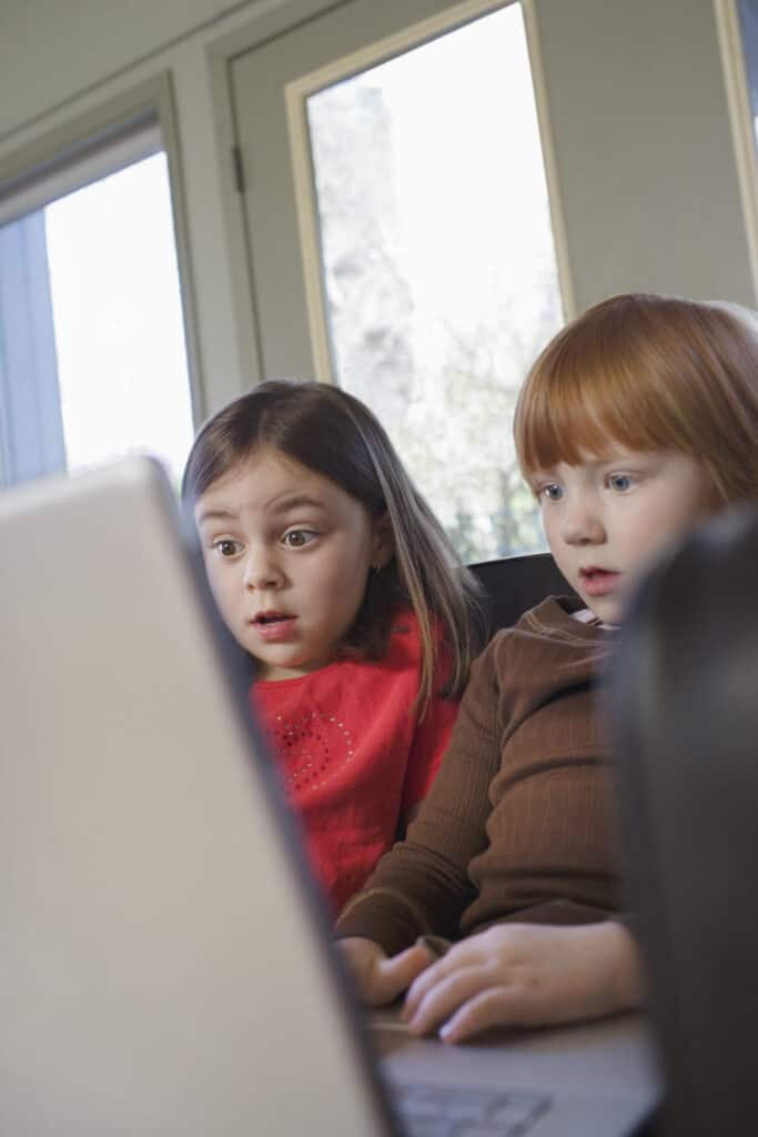 two children not practicing family internet safety