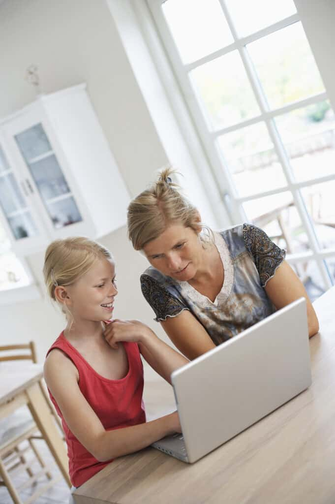 mom teaching daughter about family internet safety