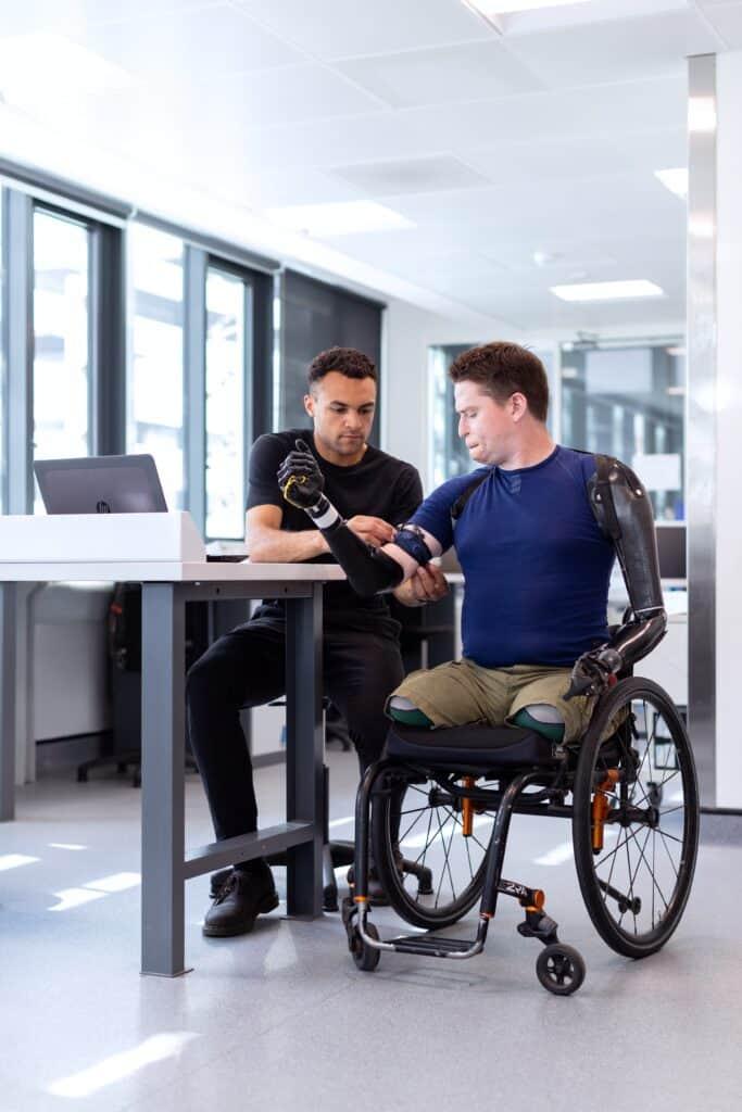 man without limbs receiving robotic arms