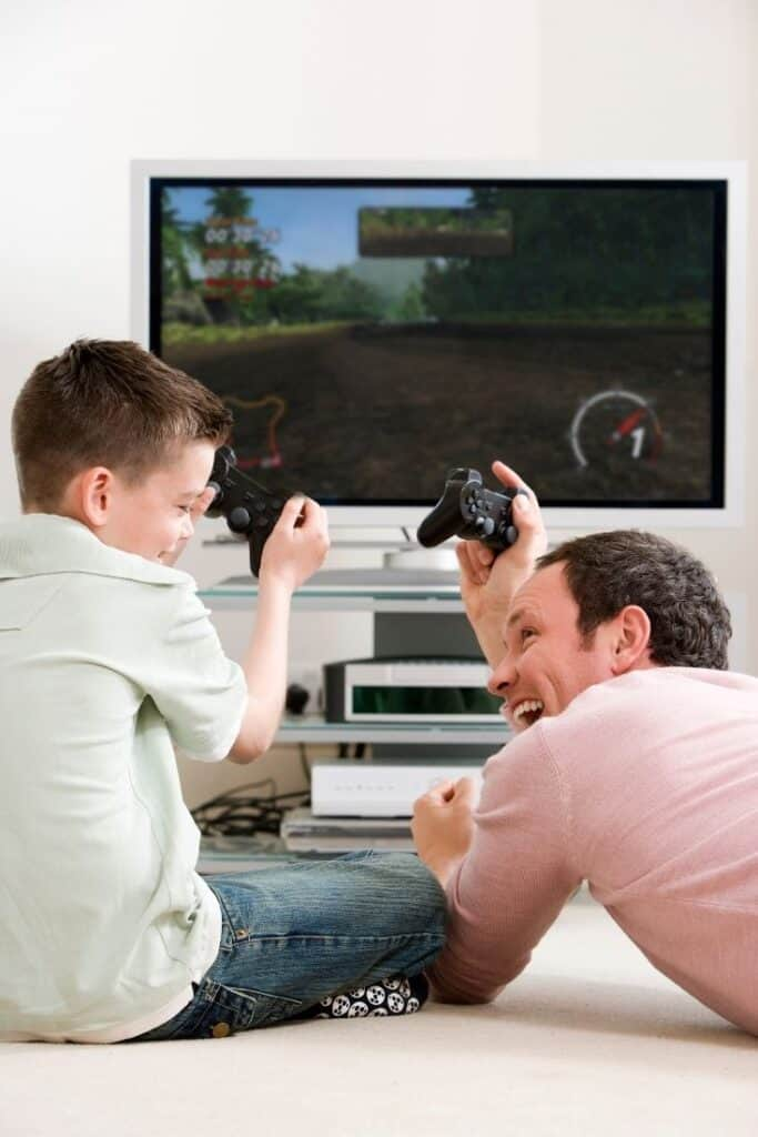 dad and boy playing a racing game together